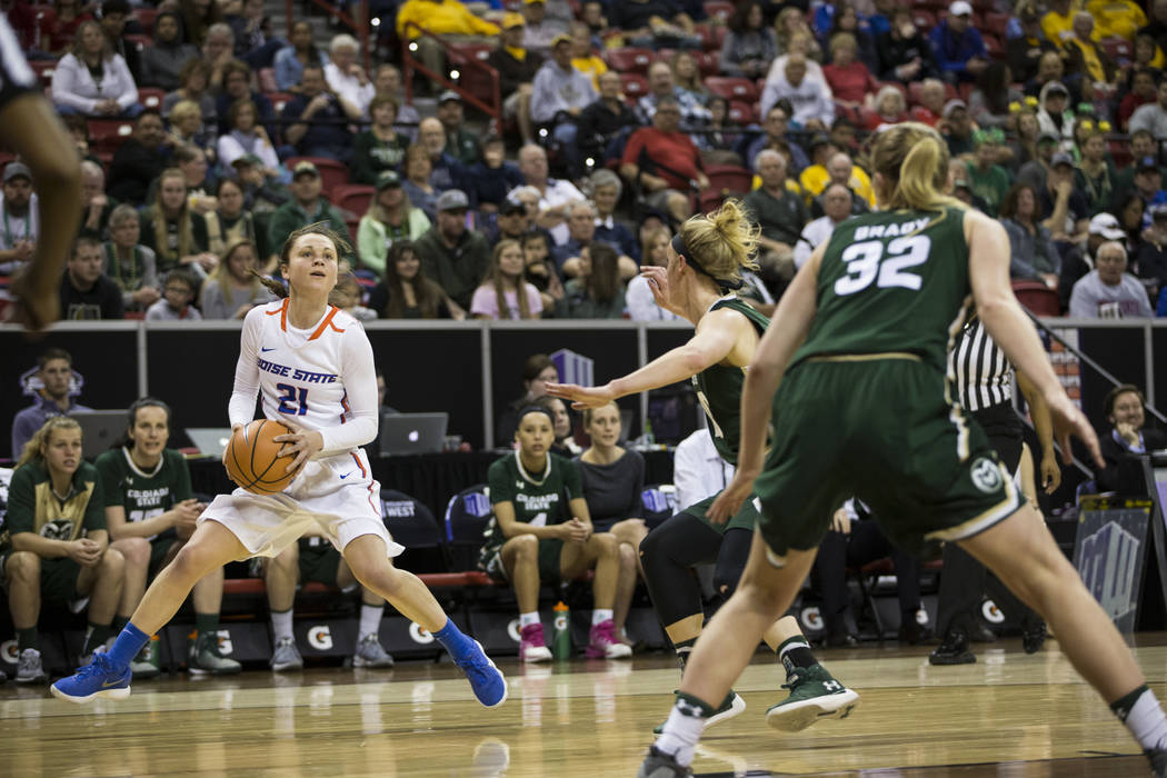 Boise State Broncos guard Riley Lupfer (21) makes space for an open shot against Colorado State Rams in the first half of the Mountain West Conference women's basketball tournament game at the Tho ...