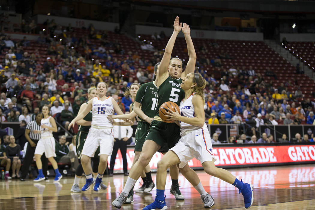 Boise State Broncos guard Braydey Hodgins (14) drives the ball to the basket under pressure from Colorado State Rams guard Sofie Tryggedsson (5) in the first half of the Mountain West Conference w ...