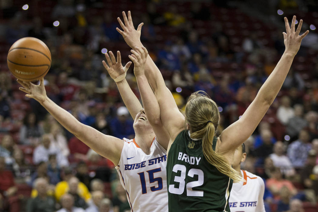 Boise State Broncos forward Tess Amundsen (15) takes a shot against Colorado State Rams forward Annie Brady (32) in the first half of the Mountain West Conference women's basketball tournament gam ...