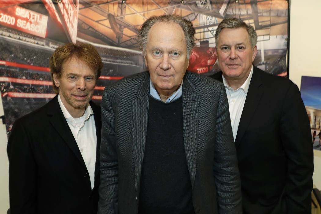 From left, Hollywood producer Jerry Bruckheimer, billionaire David Bonderman, and Oak View Group Chief Executive Tim Leiweke pose for a photo before an AP interview, Wednesday, Feb. 28, 2018, in S ...