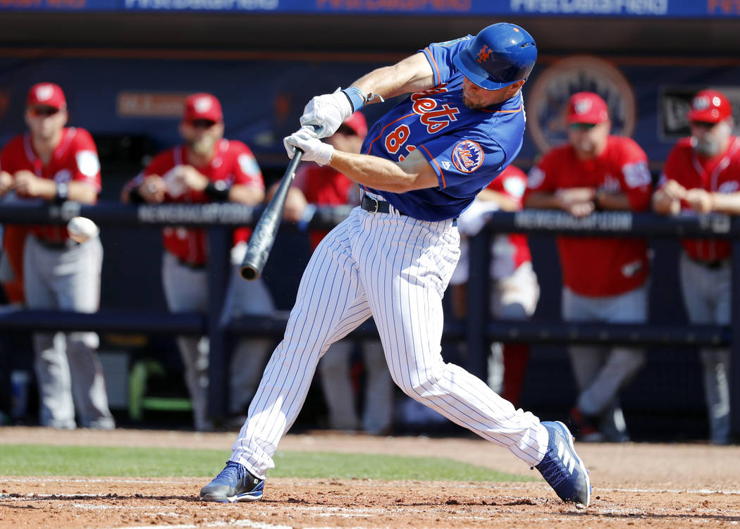 New York Mets' Tim Tebow singles during the fourth inning of an exhibition spring training baseball game against the Washington Nationals, Friday, March 2, 2018, in Port St. Lucie, Fla. (AP Photo/ ...