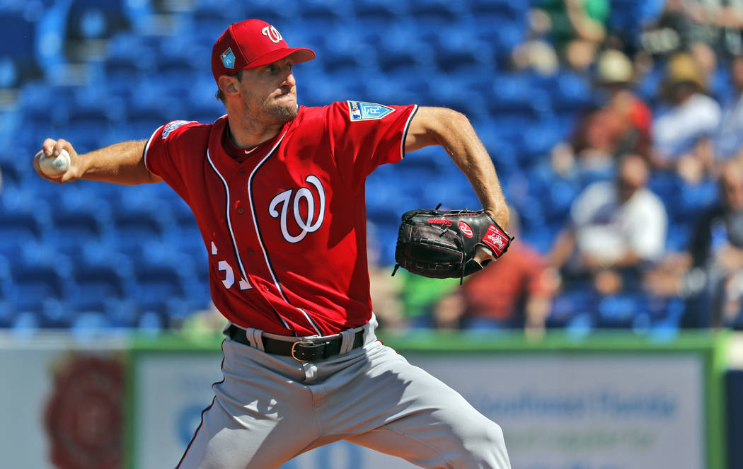 Washington Nationals starting pitcher Max Scherzer throws during the first inning of an exhibition spring training baseball game against the New York Mets, Friday, March 2, 2018, in Port St. Lucie ...