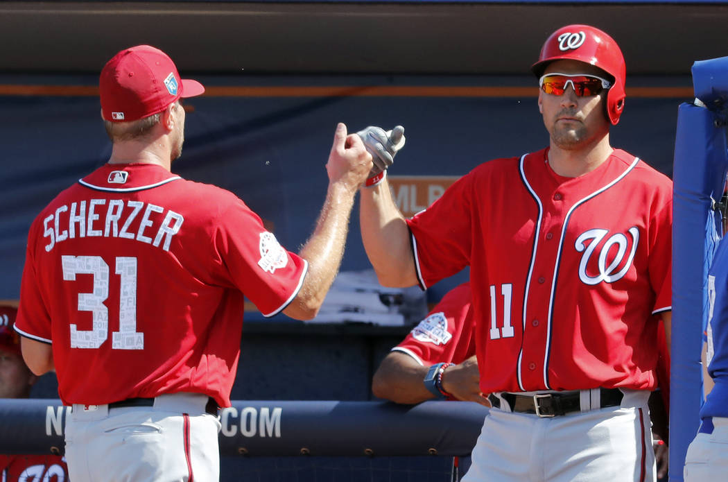 Washington Nationals starting pitcher Max Scherzer (31) is congratulated by teammate Ryan Zimmerman as he comes off the field  during the third inning of an exhibition spring training baseball gam ...