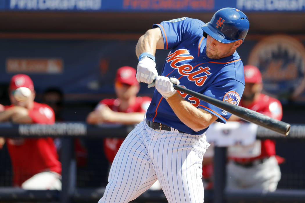 New York Mets' Tim Tebow swings during the second inning of an exhibition spring training baseball game against the Washington Nationals Friday, March 2, 2018, in Port St. Lucie, Fla. (AP Photo/Je ...