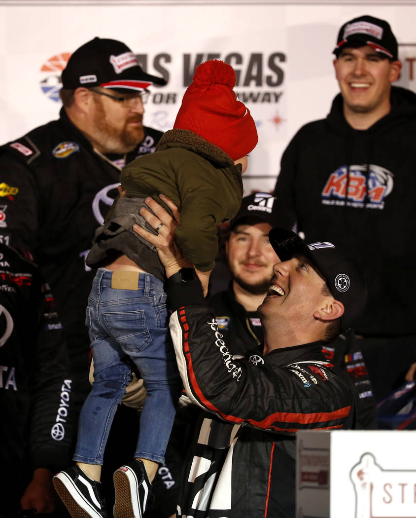 Kyle Busch (51) celebrates with his son after winning his 50th career Camping World Truck Series race at the Las Vegas Motor Speedway in Las Vegas on Friday, March 2, 2018. Andrea Cornejo Las Vega ...
