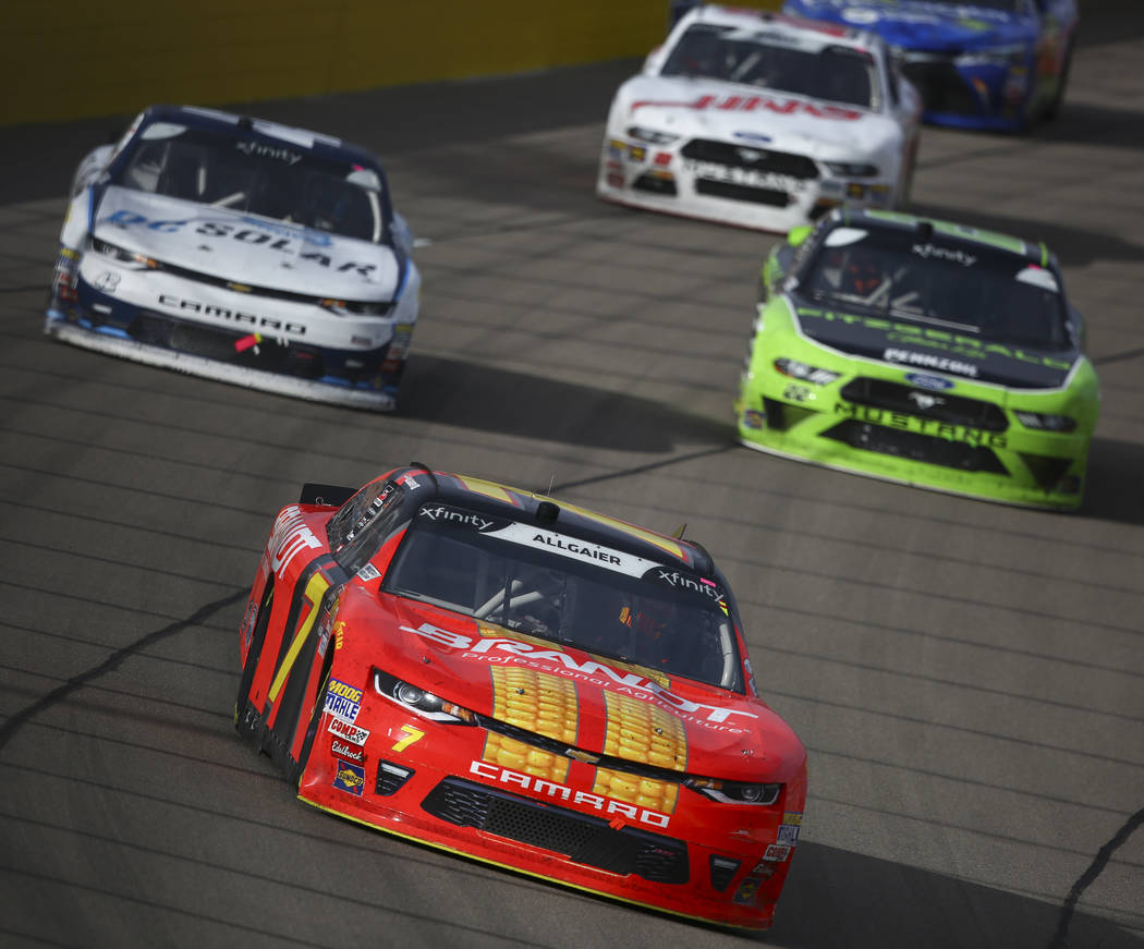 Justin Allgaier (7) gets a brief lead over Kyle Larson (42) during the NASCAR Xfinity Series Boyd Gaming 300 auto race at the Las Vegas Motor Speedway in Las Vegas on Saturday, March 3, 2018. Chas ...