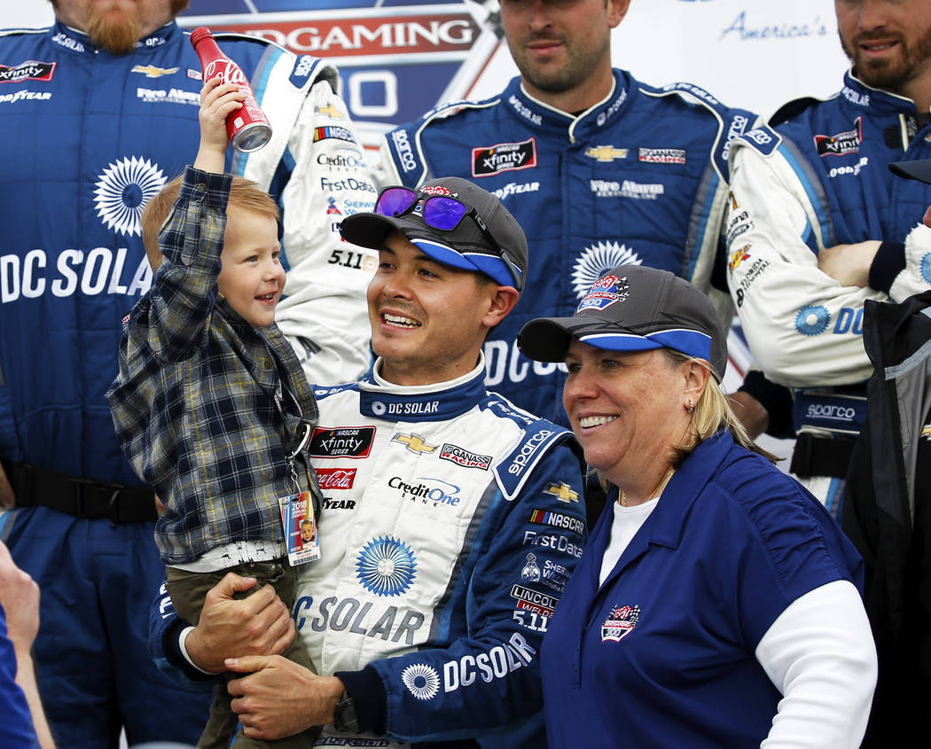 Kyle Larson (42) celebrates with his son Owen after winning the NASCAR Xfinity Series Boyd Gaming 300 auto race at the Las Vegas Motor Speedway in Las Vegas, on Saturday, March 3, 2018. (Andrea Co ...