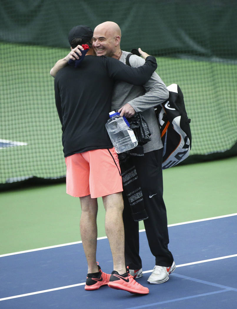 Andre Agassi, right, who coaches tennis player Novak Djokovic, not pictured, greets coach and former player Darren Cahill at Life Time Fitness in Henderson on Friday, March 2, 2018. Chase Stevens  ...