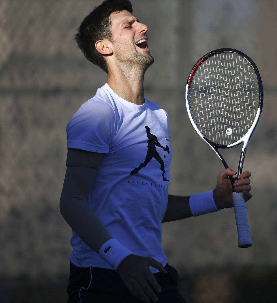 Tennis player Novak Djokovic reacts after a bad hit while training with his coach, Andre Agassi, not pictured, at Life Time Fitness in Henderson on Friday, March 2, 2018. Djokovic is preparing for ...