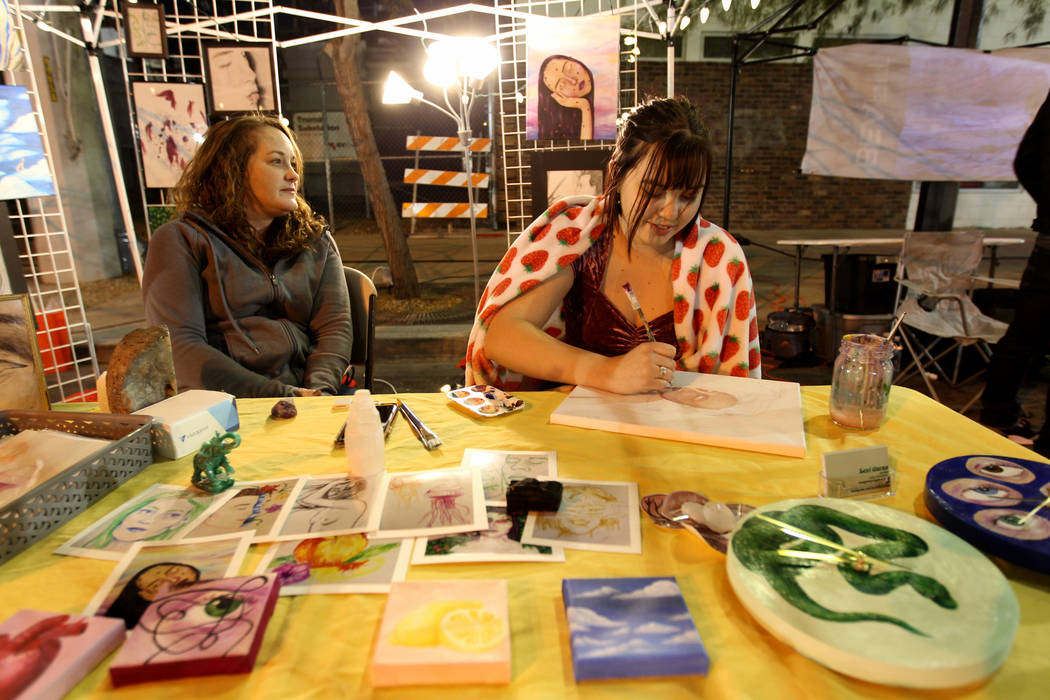 Artist Lexi Garza, right, works in her booth with her mother Heather Garza during First Friday in downtown Las Vegas' arts district Friday, March 2, 2018. K.M. Cannon Las Vegas Review-Journal @KMC ...