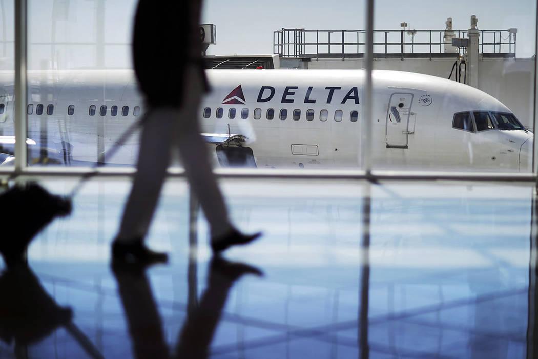 A Delta Air Lines jet sits at a gate at Hartsfield-Jackson Atlanta International Airport in Atlanta in 2016. (AP Photo/David Goldman, File)
