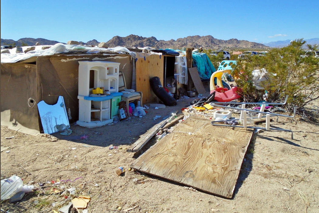 A ramshackle structure, where authorities say a couple, their three children and dozens of cats were living in filthy conditions, is seen in unincorporated Joshua Tree in Southern California's Moj ...