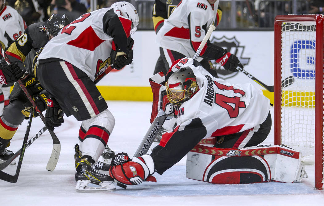Ottawa Senators goaltender Craig Anderson (41) makes a save against the Vegas Golden Knights during the second period of an NHL hockey game Friday, March 2, 2018, in Las Vegas. (AP Photo/L.E. Baskow)