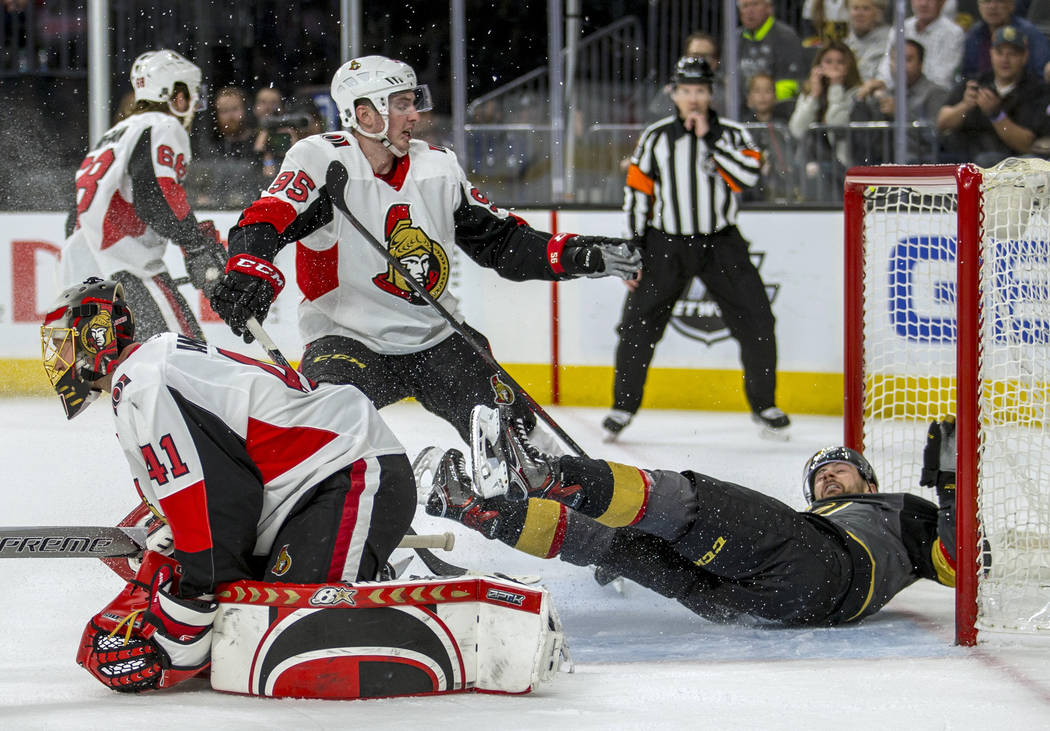 Vegas Golden Knights left wing Tomas Tatar (90) is sent into the net by Ottawa Senators center Matt Duchene (95), who was penalized during the second period of an NHL hockey game Friday, March 2,  ...