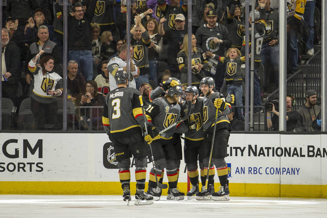The Vegas Golden Knights celebrate their first goal over the Ottawa Senators during the first period of an NHL hockey game Friday, March 2, 2018, in Las Vegas. (AP Photo/L.E. Baskow)