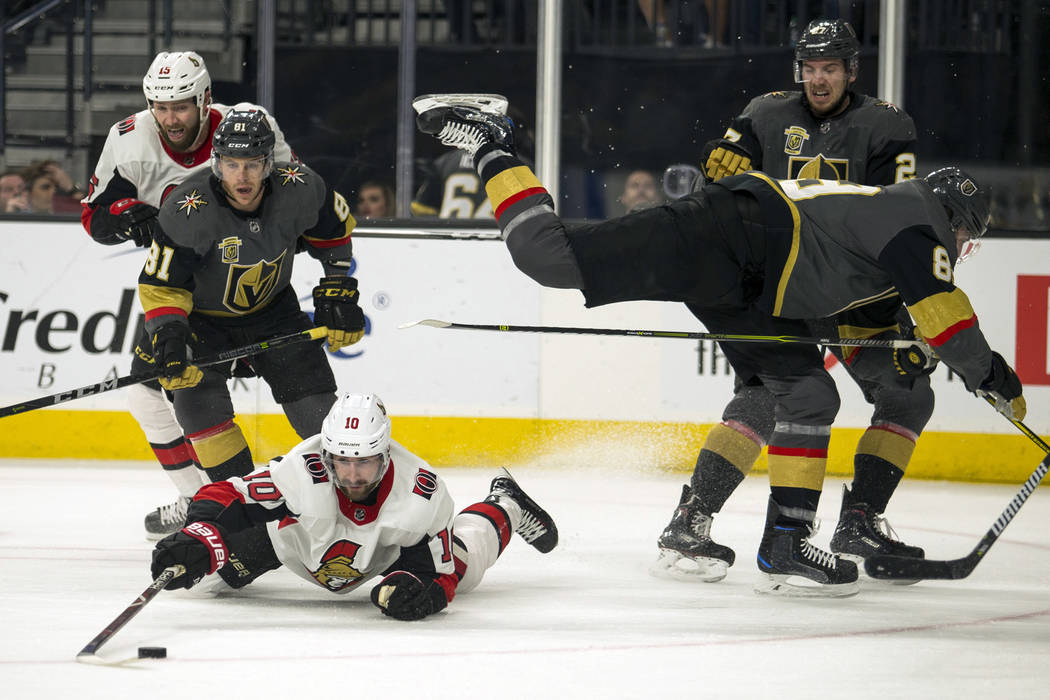 Ottawa Senators left wing Tom Pyatt (10) dives to a puck as Vegas Golden Knights defenseman Nate Schmidt (88) flies past during the first period of an NHL hockey game Friday, March 2, 2018, in Las ...