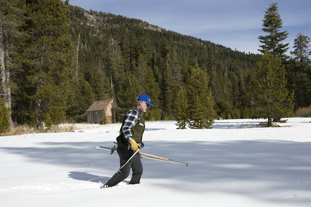 Frank Gehrke, chief of the California Cooperative Snow Surveys Program for the Department of Water Resources, crosses a snow covered meadow as he conducts the second snow survey of the season near ...