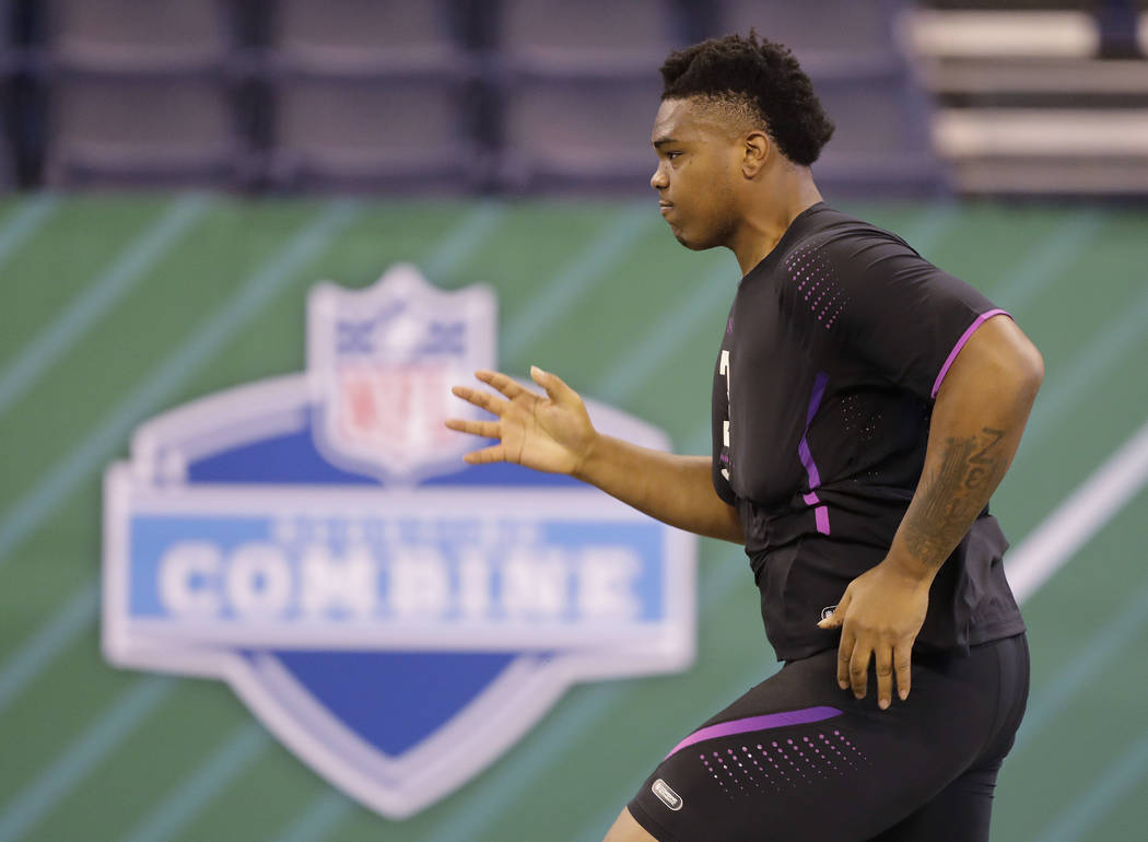 Oklahoma offensive lineman Orlando Brown runs the 40-yard dash during the NFL football scouting combine, Friday, March 2, 2018, in Indianapolis. (AP Photo/Darron Cummings)