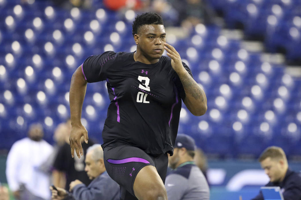 Oklahoma offensive lineman Orlando Brown participates in the 40-yard dash at the 2018 NFL Scouting Combine on Friday, March 2, 2018, in Indianapolis. (AP Photo/Gregory Payan)