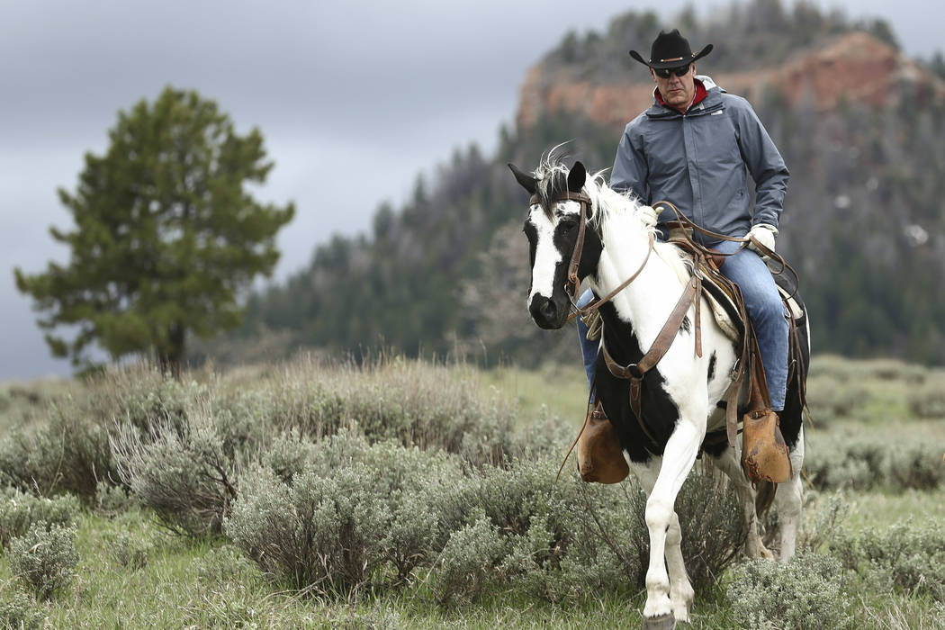 Interior Secretary Ryan Zinke takes a horseback ride in the Bears Ears National Monument with local and state representatives in Blanding, Utah, in 2017. (Scott G Winterton/The Deseret News via AP ...