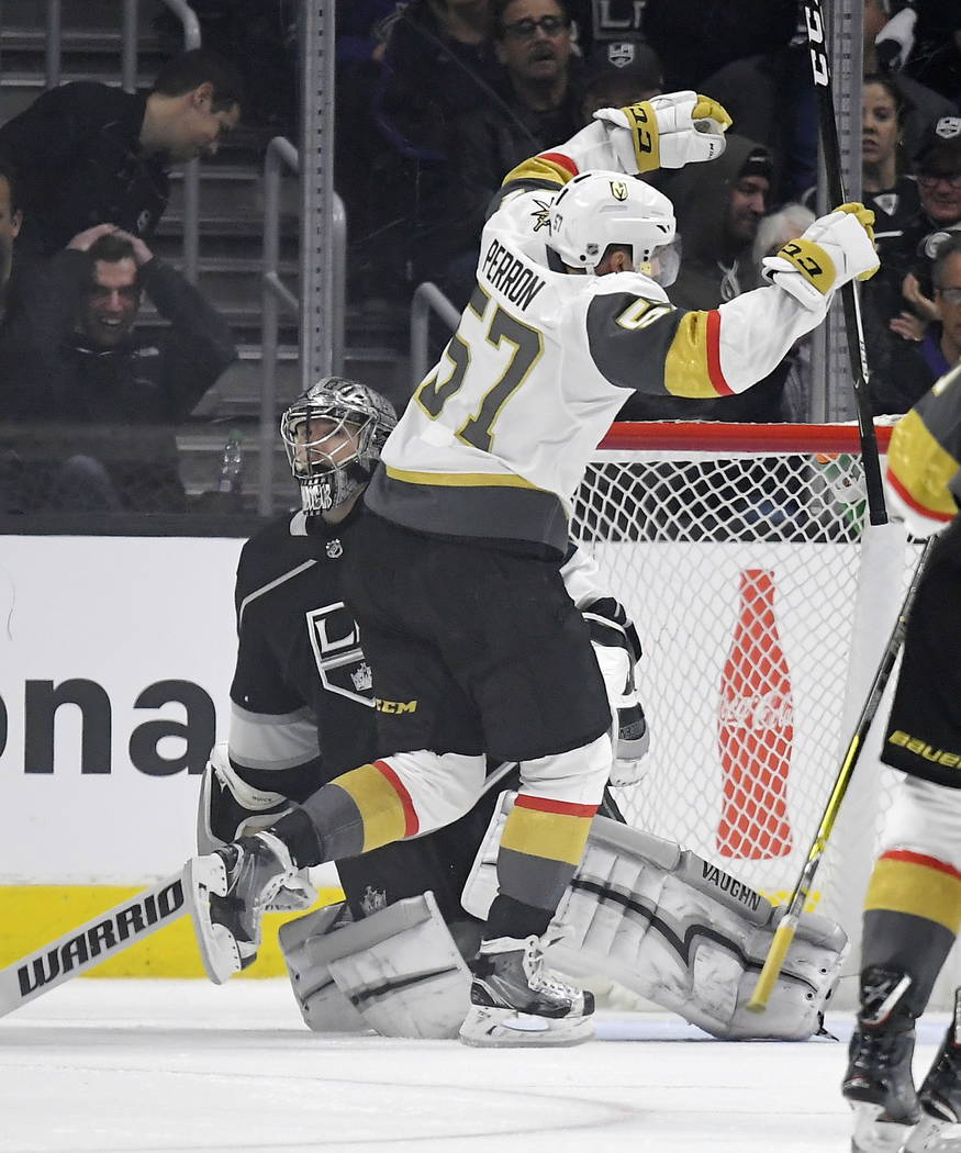 Vegas Golden Knights left wing David Perron, right, celebrates his overtime goal as Los Angeles Kings goalie Jonathan Quick watches during an NHL hockey game, Thursday, Dec. 28, 2017, in Los Angel ...