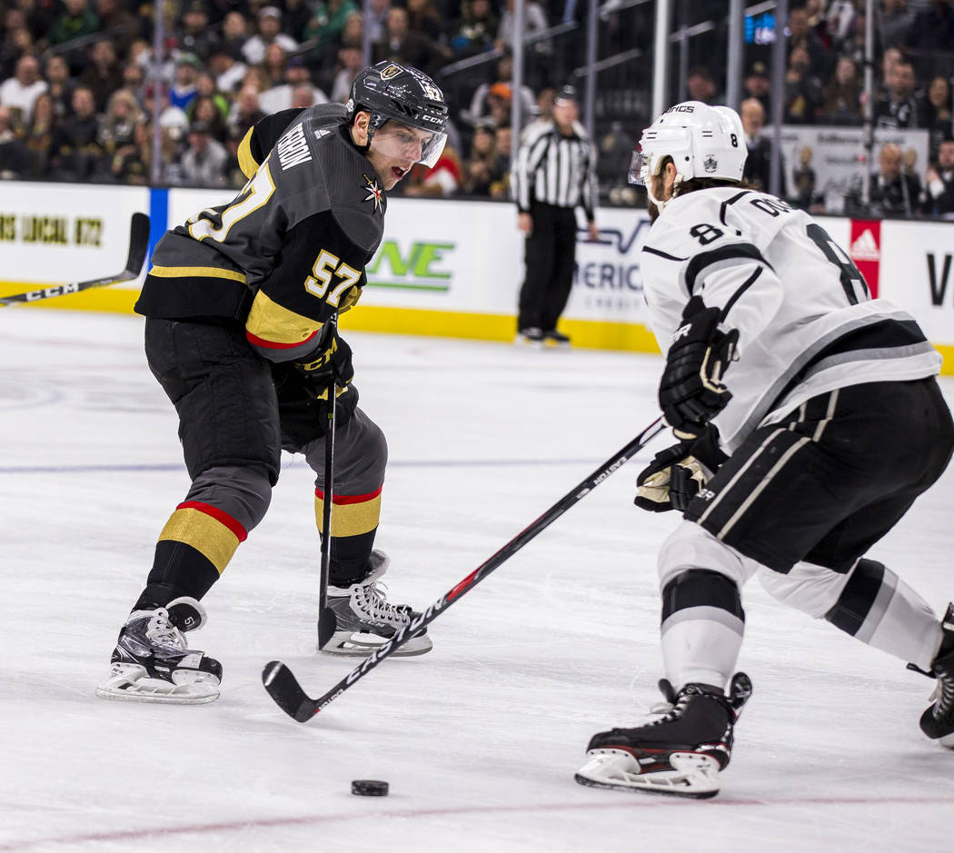 Vegas Golden Knights left wing David Perron (57) tries to take the puck around Los Angeles Kings defenseman Drew Doughty (8) during the first period of an NHL hockey game at T-Mobile Arena on Tues ...