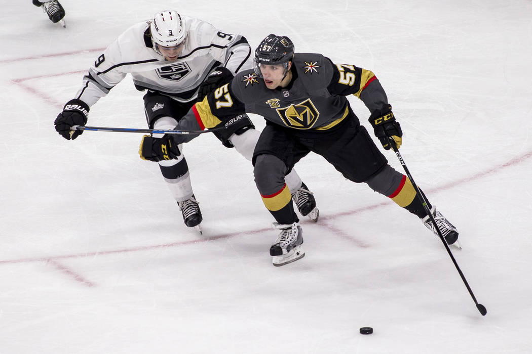 Vegas Golden Knights left wing David Perron (57) tries to get ahead of Los Angeles Kings left wing Adrian Kempe (9) during the second period of an NHL hockey game at T-Mobile Arena on Tuesday, Feb ...
