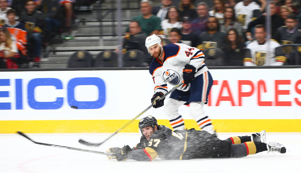 Golden Knights left wing David Perron (57) falls to the ice next to Edmonton Oilers right wing Zack Kassian (44) during an NHL game at T-Mobile Arena in Las Vegas on Thursday, Feb. 15, 2018. Chase ...