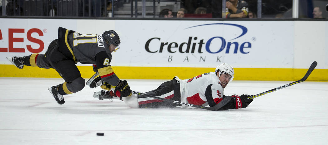 Ottawa Senators defenseman Cody Ceci (5) looks to the puck as Vegas Golden Knights center Jonathan Marchessault (81) tumbles behind him during the second period of an NHL hockey game Friday, March ...