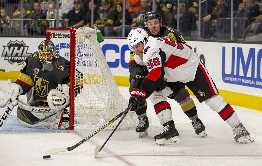 Ottawa Senators left wing Magnus Paajarvi (56) looks for a shot attempt with Vegas Golden Knights left wing Erik Haula (56) on his back during the third period of an NHL hockey game Friday, March  ...