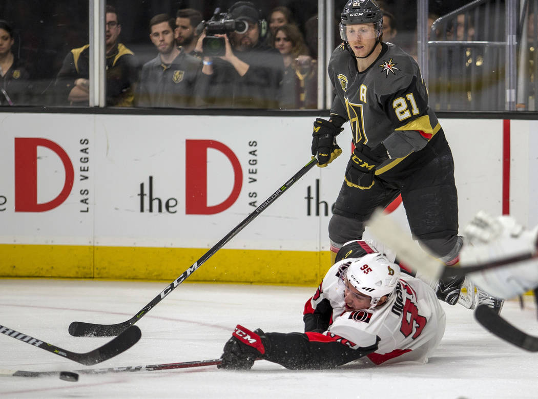 Ottawa Senators center Matt Duchene (95) continues to hit the puck after being taken down from behind by Vegas Golden Knights center Cody Eakin (21) during the third period of an NHL hockey game F ...