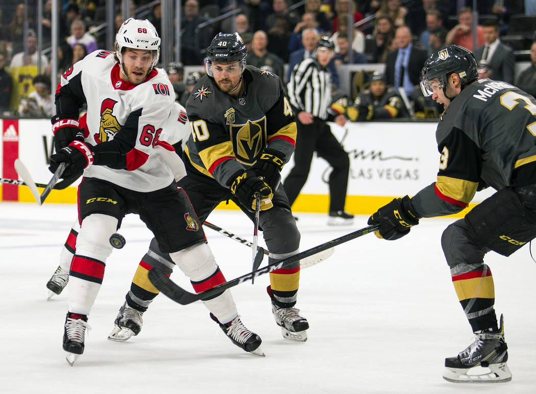 Ottawa Senators left wing Mike Hoffman (68) slaps a shot with Vegas Golden Knights center Ryan Carpenter (40) over his shoulder during the third period of an NHL hockey game Friday, March 2, 2018, ...