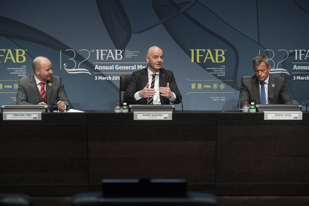 Fifa's president, Gianni Infantino, center, speaks next to Jonathan Ford, Chief Executive Football Association of Wales, left, and Martin Glenn, Chief Executive Football Association, during the pr ...