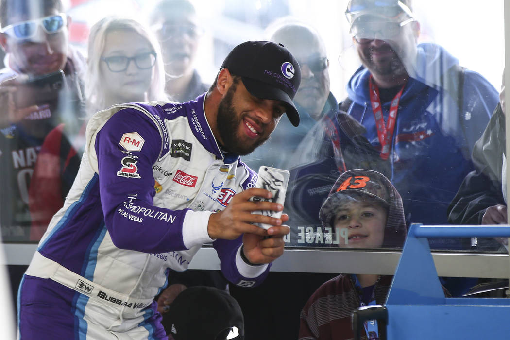 Monster Energy NASCAR Cup Series driver Darrell Wallace Jr. (43) takes a selfie with fans at the Las Vegas Motor Speedway in Las Vegas on Saturday, March 3, 2018. Chase Stevens Las Vegas Review-Jo ...