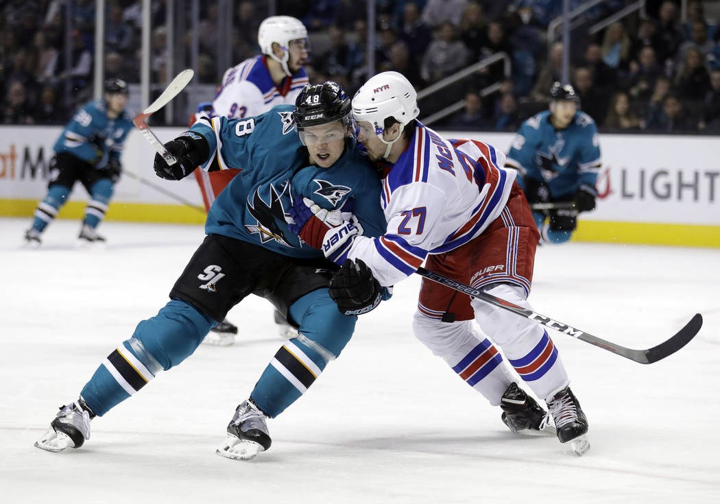 San Jose Sharks' Tomas Hertl (48) is defended by New York Rangers' Ryan McDonagh (27) during the second period of an NHL hockey game Thursday, Jan. 25, 2018, in San Jose, Calif. (AP Photo/Marcio J ...