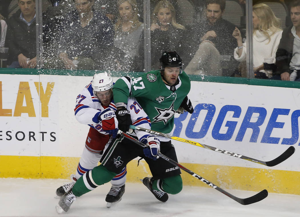 New York Rangers defenseman Ryan McDonagh (27) and Dallas Stars right wing Alexander Radulov (47) collide during the third period of an NHL hockey game Monday, Feb. 5, 2018, in Dallas. The Stars w ...