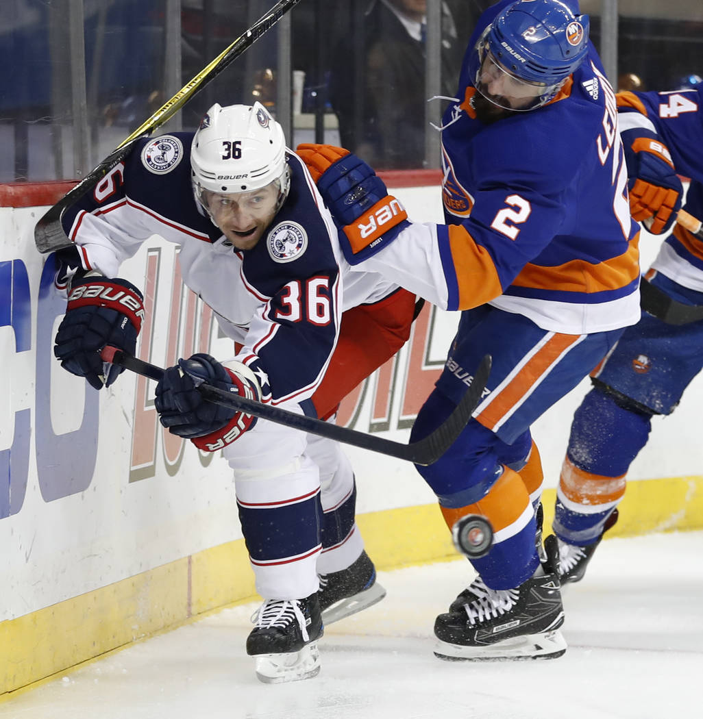 New York Islanders defenseman Nick Leddy (2) uses his stick against Columbus Blue Jackets left wing Jussi Jokinen (36) of Finland during the first period of an NHL hockey game in New York, Tuesday ...