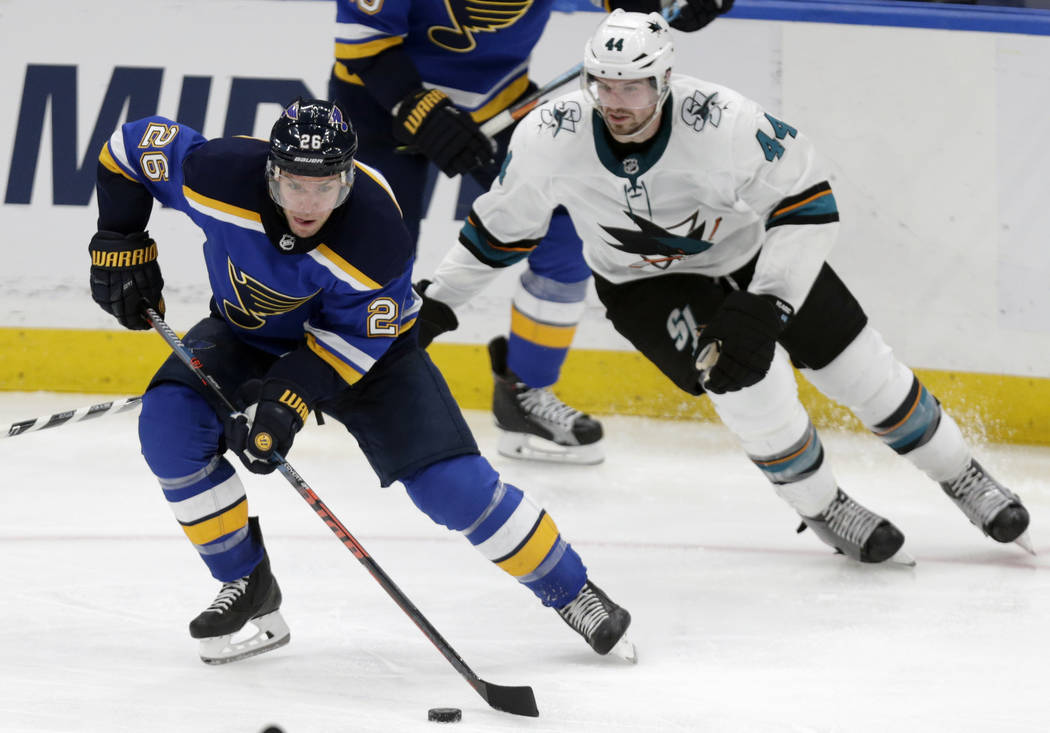 St. Louis Blues' Paul Stastny (26) controls the puck in front of San Jose Sharks' Marc-Edouard Vlasic (44) during the third period of an NHL hockey game Tuesday, Feb. 20, 2018, in St. Louis. The S ...