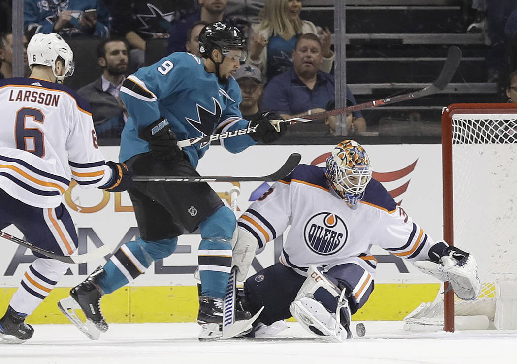 Edmonton Oilers goaltender Cam Talbot, right, stops a shot from San Jose Sharks' Evander Kane during the first period of an NHL hockey game Tuesday, Feb. 27, 2018, in San Jose, Calif. (AP Photo/Ma ...