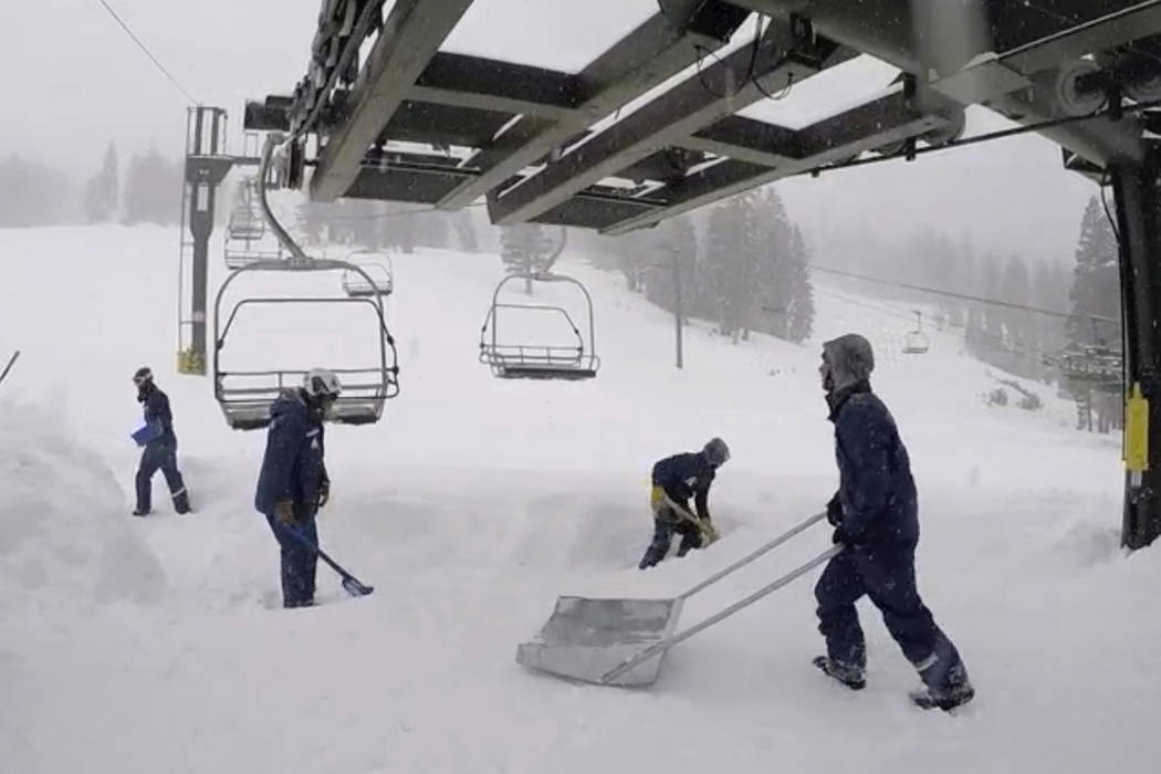 Fresh snow is cleared below a ski lift Friday in Kirkwood, Calif. (Kirkwood Mountain Resort via AP)