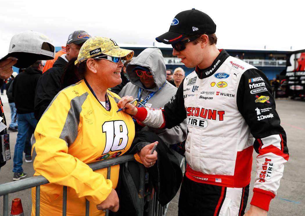 Debbie Smith, of Reno, gets her shirt signed by Brad Keselowski at the Las Vegas Motor Speedway in Las Vegas on Saturday, March 3, 2018. Andrea Cornejo Las Vegas Review-Journal @DreaCornejo