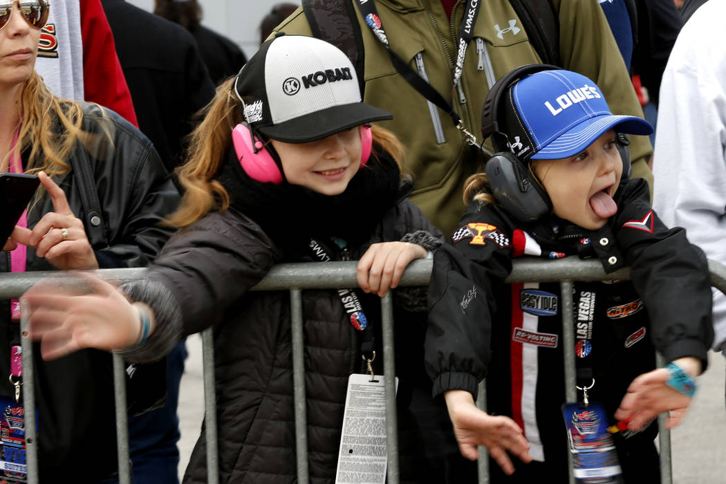 Mia, 9, and Kellan, 5, wave at drivers as they return to the Neon Garage at the Las Vegas Motor Speedway in Las Vegas on Saturday, March 3, 2018. Andrea Cornejo Las Vegas Review-Journal @DreaCornejo