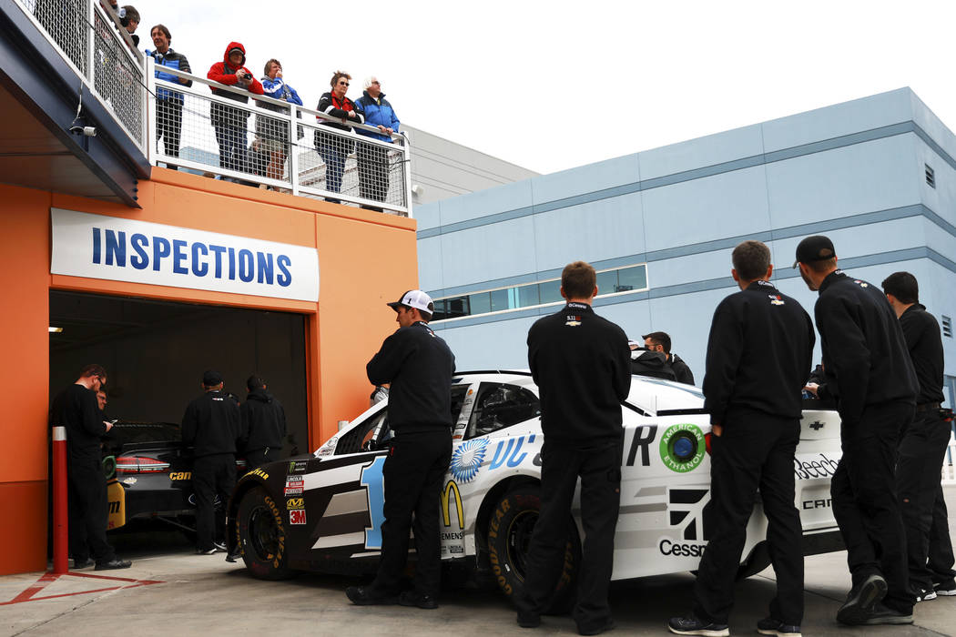 Attendees watch as Jamie McMurray's (1) pit crew wait for inspections at the Las Vegas Motor Speedway in Las Vegas on Saturday, March 3, 2018. Andrea Cornejo Las Vegas Review-Journal @DreaCornejo