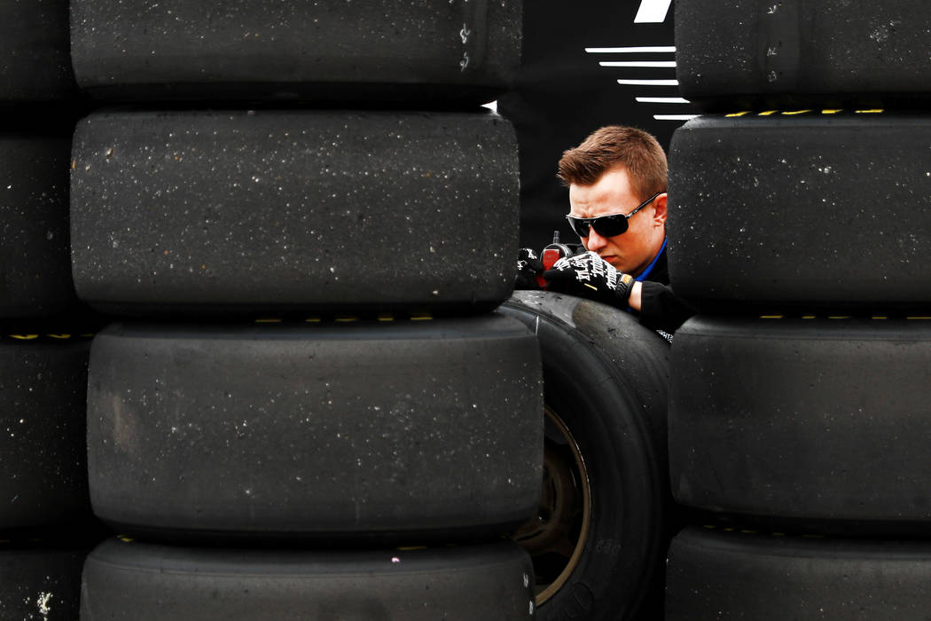 An employee works on a set of tires at the Las Vegas Motor Speedway in Las Vegas on Saturday, March 3, 2018. Andrea Cornejo Las Vegas Review-Journal @DreaCornejo