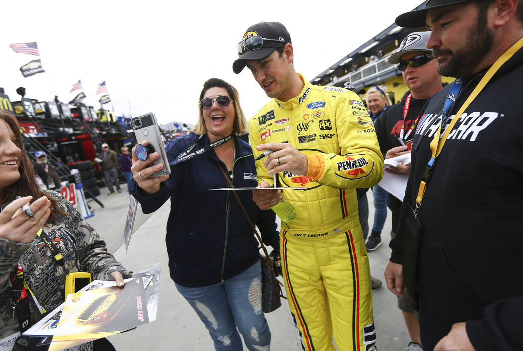 Monster Energy NASCAR Cup Series driver Joey Logano (22) takes a selfie with Liz Okeson of Cedar City, Utah at the Las Vegas Motor Speedway in Las Vegas on Saturday, March 3, 2018. Chase Stevens L ...