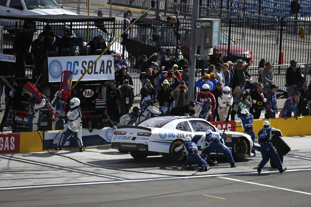 Kyle Larson's (42) pit crew work on his car during the NASCAR  Xfinity Series Boyd Gaming 300 auto race at the Las Vegas Motor Speedway in Las Vegas on Saturday, March 3, 2018. He earned his ninth ...