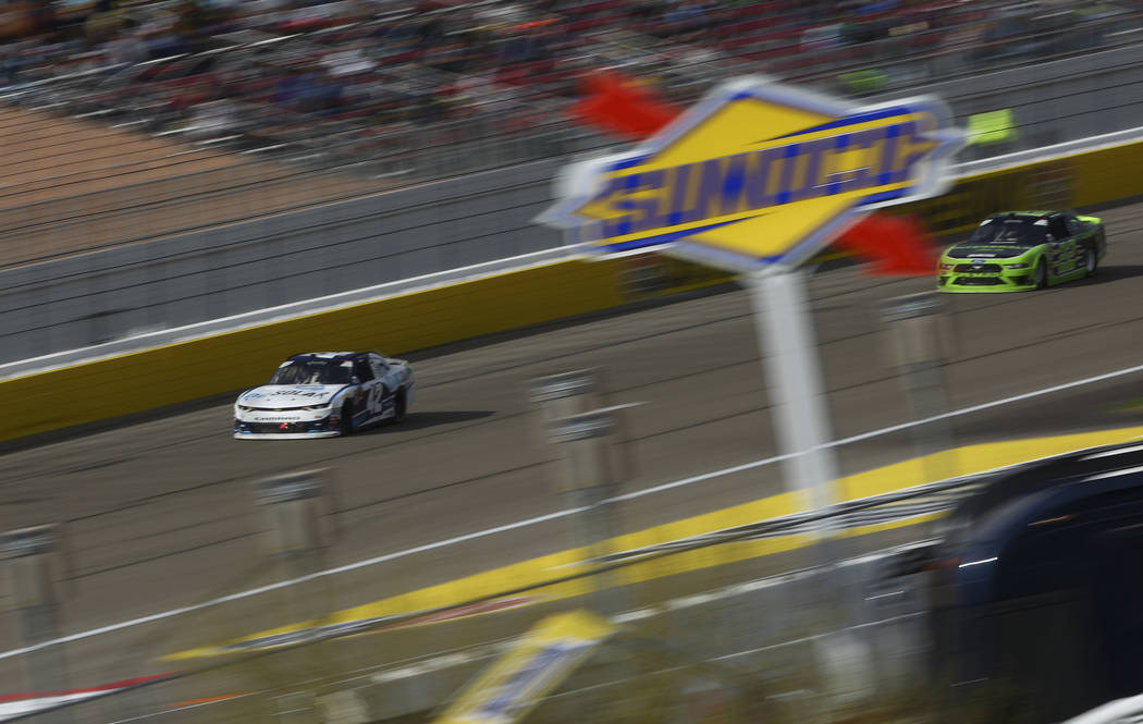 Kyle Larson (42) maintains a lead over Ryan Blaney (22) during the NASCAR Xfinity Series Boyd Gaming 300 auto race at the Las Vegas Motor Speedway in Las Vegas on Saturday, March 3, 2018. Chase St ...
