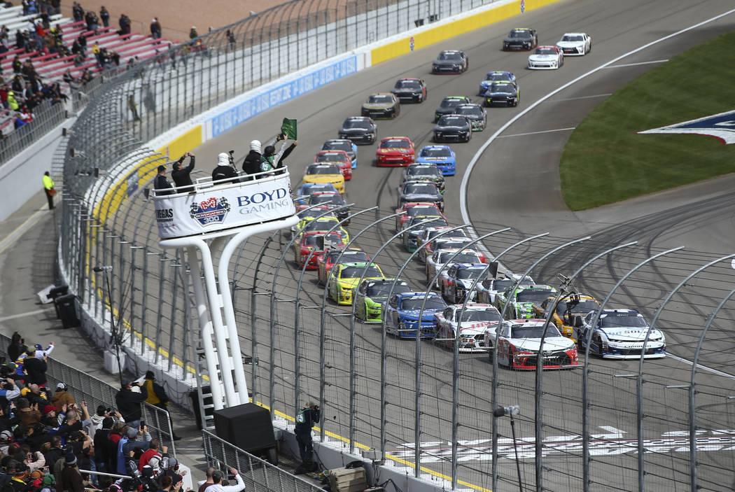 The green flag is waved for the start of the NASCAR Xfinity Series Boyd Gaming 300 auto race at the Las Vegas Motor Speedway in Las Vegas on Saturday, March 3, 2018. Chase Stevens Las Vegas Review ...