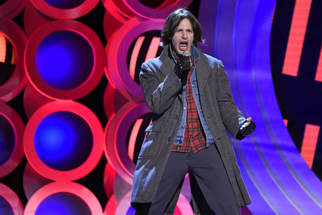 """Andy Samberg performs """"Don't You Forget About Me"""" at the 33rd Film Independent Spirit Awards on Saturday, March 3, 2018, in Santa Monica, Calif. (Photo by Chris Pizzello/Invision/AP)"""