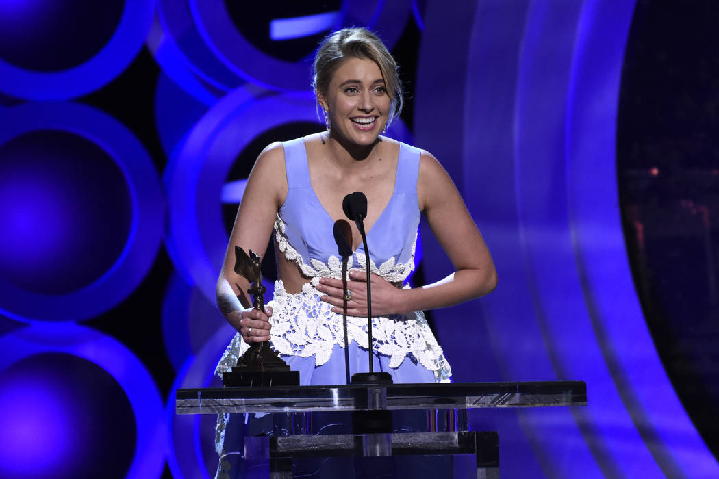 """Greta Gerwig accepts the award for best screenplay for """"Lady Bird"""" at the 33rd Film Independent Spirit Awards on Saturday, March 3, 2018, in Santa Monica, Calif. (Photo by Chris Pizzello ..."""
